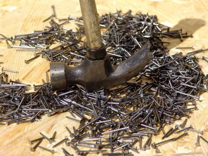 Hammer - nail puller and pile of nails
