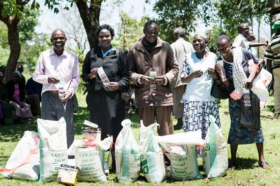 Farmers with Fertilizer bags