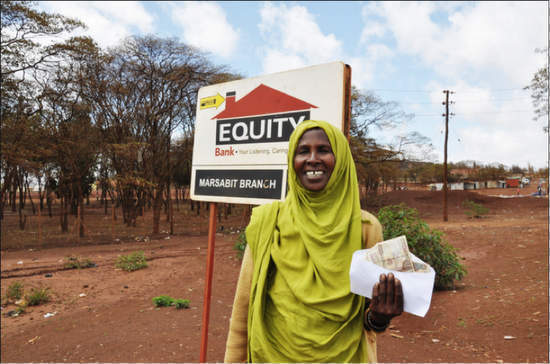A Kenyan livestock keeper in Marsabit receives an insurance payout after a prolonged drought in the region. (Photo: J. Haskins - Burness)