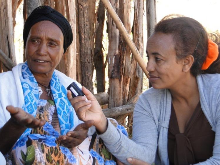 Mulu interviewing farmer Ethiopia